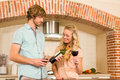 Cute couple enjoying a glass of wine and reading the bottle Royalty Free Stock Photo