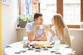 Cute couple having breakfast together n the kitchen Royalty Free Stock Photo