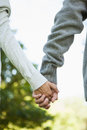 Cute couple holding hands in the park on a sunny day Stock Photo