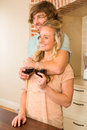 Cute couple hugging and enjoying a glass of wine Royalty Free Stock Photo