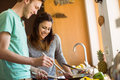 Cute couple preparing food together at home in the kitchen Stock Photos