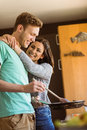 Cute couple preparing food together at home in the kitchen Royalty Free Stock Image
