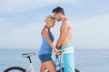 Cute couple together with their bicycles on beach Royalty Free Stock Photos
