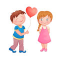Cute couple on valentine s day boy giving a heart balloon to a beautiful little girl Royalty Free Stock Photo