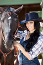 Cute cowgirl on ranch Stock Image