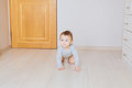 Cute crawling funny baby boy indoors at home Royalty Free Stock Photo