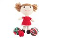 Cute crocheted doll in red dress handcrafted a with balls of yarn Stock Images