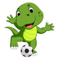 Cute crocodile playing football
