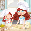 Cute curly hair mom and daughter baking cookies on kitchen Stock Image
