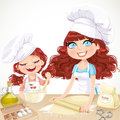 Cute curly hair mom and daughterl baking cookies isolated on white background Royalty Free Stock Photos