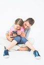 Cute daughter and mother sitting with pet kitten together Royalty Free Stock Photo