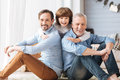 Cute delighted child hugging his father and grandfather Royalty Free Stock Photo
