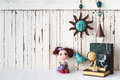 Cute dolls with vintage objects style wooden background with cop