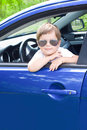 Cute driver in blue car Stock Images