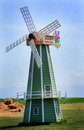 Cute dutch windmill a decorated sits under clear blue skies Stock Photo