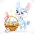 Cute easter bunny with a basket of eggs isolated on white background Stock Photo