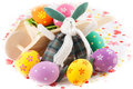 Cute easter bunny rabbit with a little wheelbarrow and eggs Stock Images