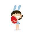 Cute easter girl with rabbit ears holding egg.