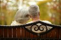 Cute elderly couple walking in autumn park Stock Photo