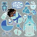 Cute elements for mulatto newborn baby boy a set of cartoon cartoon icons scrapbooking in polka dot background Royalty Free Stock Photo