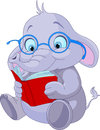 Cute elephant with glasses reading a book Royalty Free Stock Photo