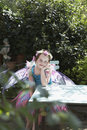 Cute Fairy Girl At Garden Table Royalty Free Stock Photo