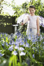 Cute fairy girl playing in flower garden young costume at Royalty Free Stock Photos