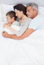 Cute family sleeping together in bed at home Stock Photo