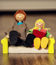 Cute family of the wooden figures, old toys Royalty Free Stock Photo