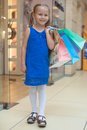 Cute fashion girl holding shopping bags and walking at the mall this image has attached release Stock Photos