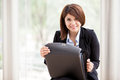 Cute female architect at work happy young on a suit opening a briefcase and smiling Royalty Free Stock Photography