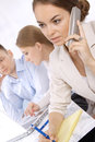 Cute female business executive with her colleagues Royalty Free Stock Photography