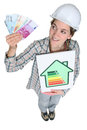 Cute female heating engineer Stock Image