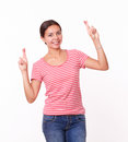 Cute female with luck fingers standing portrait of on red t shirt and blue jeans and smiling at you on isolated white background Stock Photos