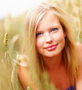 Cute female smiling while at a field Stock Photography