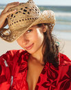 Cute female wearing a cane hat at the beach Stock Images