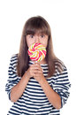 Cute fun little girl holding big lolly pop on white background Royalty Free Stock Images