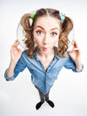 Cute funny girl with two pony tails wide angle shot view from above Stock Photo