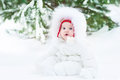 Cute funny little baby in winter park under big tree boy hugging his sister a beautiful Royalty Free Stock Photo