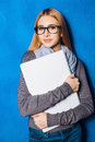 Cute girl against blue wall Royalty Free Stock Photo