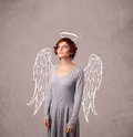 Cute girl with angel illustrated wings on grungy background Royalty Free Stock Photos
