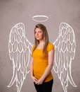 Cute girl with angel illustrated wings on grungy background Stock Photo
