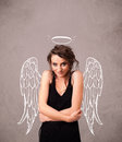 Cute girl with angel illustrated wings on grungy background Royalty Free Stock Image