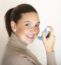 Cute girl with asthma inhalator Stock Photography