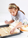 Cute girl baking cookies Royalty Free Stock Photos