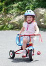 Cute girl on bike Royalty Free Stock Photos