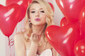Cute girl blowing a kiss valentines sweet kisses Royalty Free Stock Photo