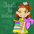 Cute girl with books at the board ready to learn Royalty Free Stock Photography