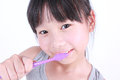 Cute girl brushing her teeth Royalty Free Stock Photo
