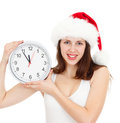 Cute girl in Christmas red santa hat with clock Stock Photos